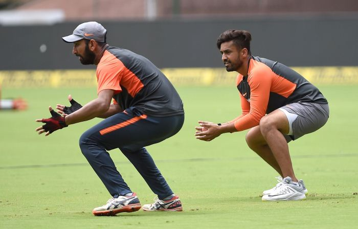 Bengaluru: India's Karun Nair and Cheteshwar Pujara during a practice session ahead of their maiden cricket test match against Afghanistan in Bengaluru on June 13, 2018.